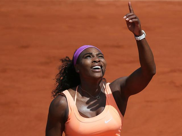Serena-Williams-gestures-she-has-trouble-returning-a-high-ball-against-the-sunlight-in-the-quarterfinal-match-of-the-French-Open-tennis-tournament-against-Italy-s-Sara-Errani-at-the-Roland-Garros-stadium-in-Paris-AP-Photo