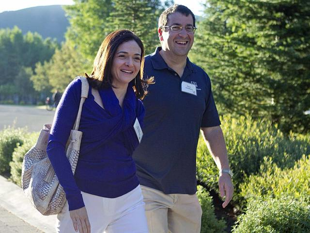 In-this-file-photo-Facebook-COO-Sheryl-Sandberg-and-her-husband-David-Goldberg-CEO-of-SurveyMonkey-arrive-at-the-Sun-Valley-Inn-Idaho-AP-Photo-Julie-Jacobson
