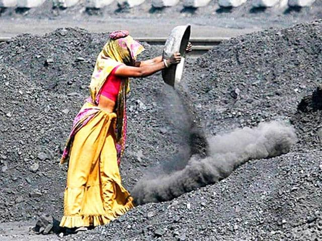 In-coal-producing-states-women-carrying-away-illegally-scavenged-coal-is-a-common-sight-Here-womenfolk-carry-coal-from-an-open-cast-coal-mine-in-Dhanbad-Jharkhand-Getty-Images-Photo