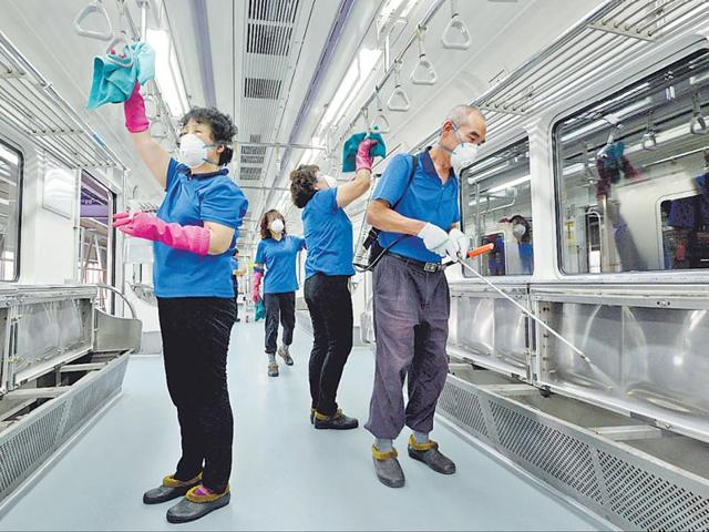 Workers-in-full-protective-gear-disinfect-the-floor-of-a-subway-station-in-Seoul-South-Korea-June-11-2015-A-South-Korean-man-with-terminal-lung-cancer-who-had-been-infected-with-MERS-virus-died-on-Thursday-in-the-10th-fatality-since-the-country-s-outbreak-began-last-month-Reuters
