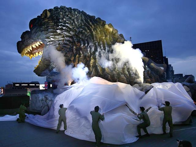 On-April-9-2015-Godzilla-s-head-is-unveiled-as-the-irradiated-monster-It-was-appointed-special-resident-and-tourism-ambassador-for-Tokyo-s-Shinjuku-ward-during-its-awards-ceremony-in-Tokyo-The-giant-Godzilla-head-towering-52-meters-171-feet-above-ground-level-was-unveiled-Thursday-at-an-office-of-Toho-the-studio-behind-the-1954-original-AP-Photo-Shizuo-Kambayashi-File