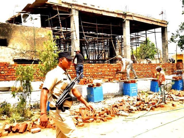 Police-personnel-patrol-the-violence-hit-Atali-Village-near-Ballabgarh-in-Faridabad