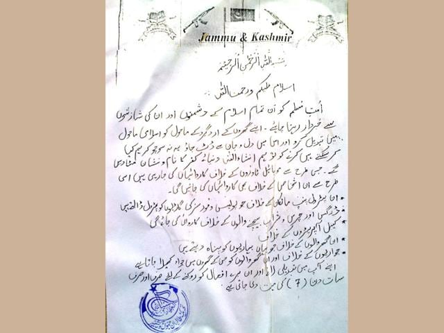 A-poster-bearing-initials-of-Tehreek-i-Taliban-which-warns-of-attacks-on-telecoms-petrol-pumps-cable-operators-and-alcohol-sellers-seen-on-Friday-in-Sopore-HT-Photo