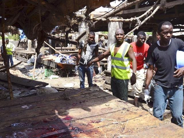 File-photo-of-rescue-workers-at-the-site-of-a-suicide-bomb-attack-at-a-market-in-Maiduguri-Nigeria-AP-Photo