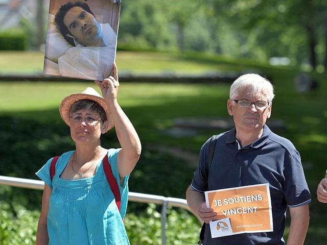 People-hold-placards-reading-I-show-support-to-Vincent-and-a-picture-of-Vincent-Lambert-a-quadriplegic-man-who-is-currently-on-artificial-life-support-in-a-hospital-in-Reims-Europe-s-rights-court-upheld-the-decision-of-a-French-court-to-allow-a-man-in-a-vegetative-state-to-be-taken-off-life-support-AFP-Photo