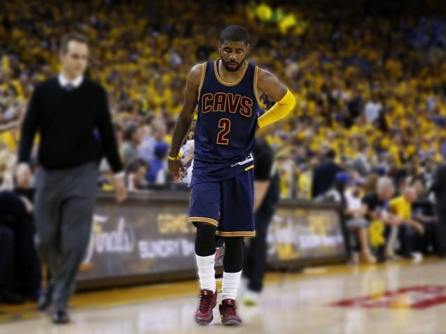Kyrie-Irving-of-the-Cleveland-Cavaliers-leaves-the-game-injured-against-the-Golden-State-Warriors-during-Game-One-of-the-2015-NBA-Finals-at-ORACLE-Arena-in-Oakland-California-AFP-PHOTO