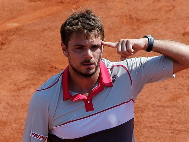 Switzerland-s-Stan-Wawrinka-reacts-after-defeating-France-s-Jo-Wilfried-Tsonga-during-their-semifinal-match-of-the-French-Open-tennis-tournament-at-the-Roland-Garros-stadium-in-Paris-Wawrinka-won-6-3-6-7-7-6-6-4-AP-Photo