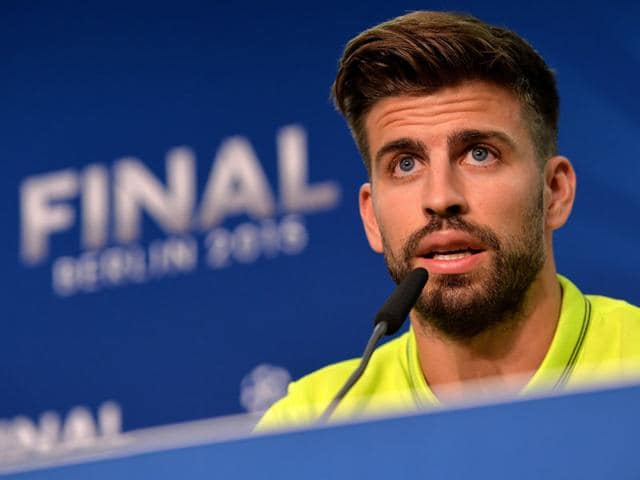 Barcelona-s-Gerard-Pique-talks-during-a-press-conference-at-the-Olympic-stadium-in-Berlin-on-the-eve-of-the-soccer-Champions-League-final-between-Juventus-Turin-and-FC-Barcelona-AP-PHOTO