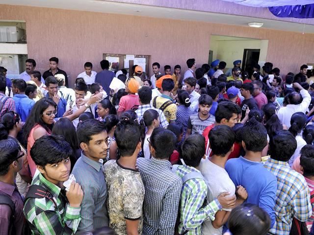 Students-fill-their-admission-forms-at-Moti-Lal-Nehru-College--on-Thursday-after-the-first-cut-off-list-of-Delhi-University-came-out-on-Wednesday-HT-Photo-Mishty-Tahiliani
