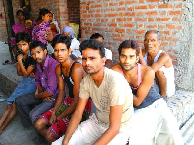 Niranjan-extreme-right-in-the-third-row-rents-rooms-to-workers-of-Nestle-factory-in-Rudrapur-Uttarkhand-Ban-on-sale-of-Maggi-has-put-a-question-mark-on-the-workers-future-Photo-Anupam-Trivedi-Hindustan-Times