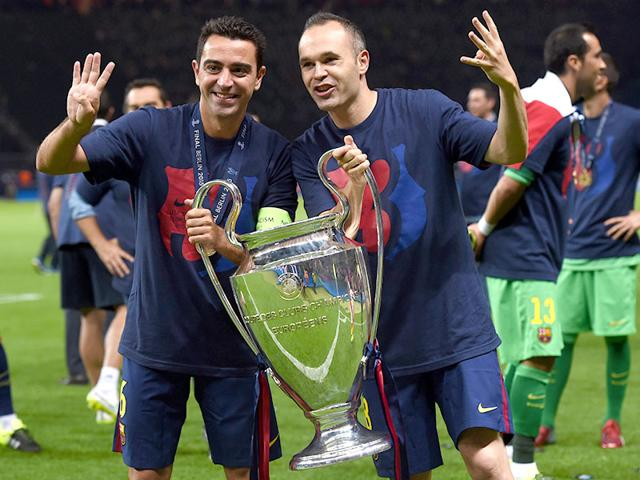Barcelona-s-midfielder-Xavi-Hernandez-and-Barcelona-s-midfielder-Andres-Iniesta-celebrate-with-the-trophy-after-the-UEFA-Champions-League-Final-football-match-between-Juventus-and-FC-Barcelona-at-the-Olympic-Stadium-in-Berlin-AFP-PHOTO
