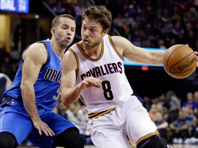 File-photo-Cleveland-Cavaliers-Matthew-Dellavedova-from-Australia-drives-past-Dallas-Mavericks-J-J-Barea-during-an-NBA-basketball-game-in-Cleveland-AP-Photo