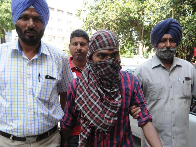 Counter-intelligence-officials-and-police-officials-taking-Deen-Bhandhu-Pater-28-a-maoist-from-Jharkhand-in-a-local-court-in-Jalandhar-Pardeep-Pandit-HT-Photo