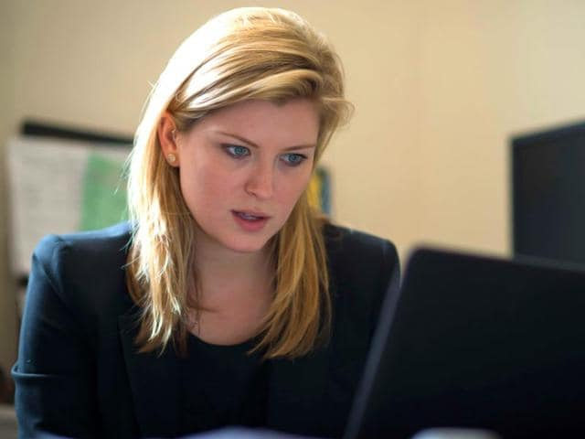 Melanie-Smith-researcher-at-the-Institute-for-Strategic-Dialogue-s-Women-and-Extremism-looks-at-a-computer-screen-during-an-interview-in-London-AFP-Photo