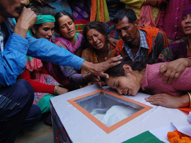 Family-members-of-martyr-Vikas-bhardwaj-wail-near-his-body-during-his-funeral-at-his-native-village-Patoon-Pandol-Ladbhrol-in-district-Mandi-on-Sunday-Birbal-Sharma-HT