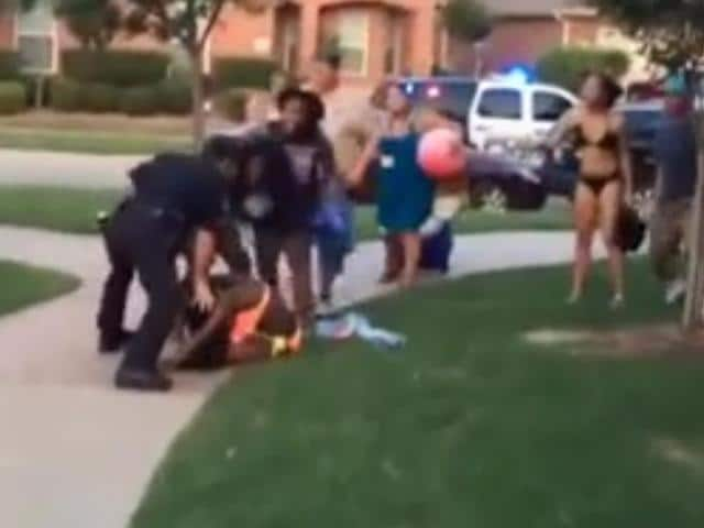 One-officer-can-be-seen-throwing-a-girl-to-the-ground-and-pinning-her-down-credits-Youtube-grab