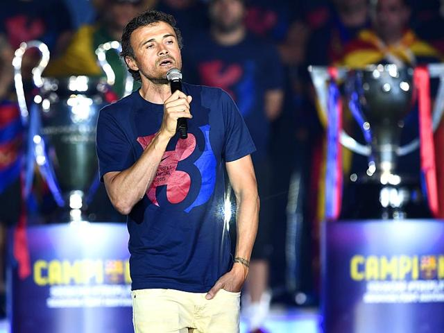 Barcelona-coach-Luis-Enrique-delivers-a-speech-during-celebrations-held-for-their-victory-over-Juventus-a-day-after-the-Uefa-Champions-League-final-at-the-Camp-Nou-stadium-in-Barcelona-on-June-7-2015-With-the-victory-Barcelona-became-the-first-team-to-twice-win-the-European-treble-AFP-Photo