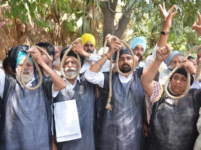 Batala-Road-residents-holding-hangman-s-nooses-during-a-protest-in-Amritsar-on-Monday-HT-Photo