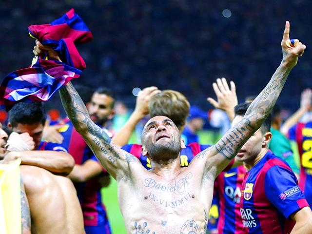 Dani-Alves-celebrates-Barcelona-s-3-1-win-in-the-Champions-League-final-against-Juventus-at-the-Olympic-Stadium-in-Berlin-on-June-6-2015-Alves-a-Brazil-international-joined-Barca-from-Sevilla-in-2008-AP-Photo