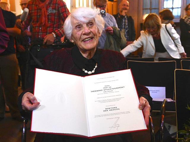 Ingeborg-Syllm-Rapoport-holds-her-doctoral-certificate-and-a-bunch-of-flowers-during-a-ceremony-at-Hamburg-The-102-year-old-was-unable-to-defend-her-thesis-in-1938-under-the-Nazi-regime-AP-Photo