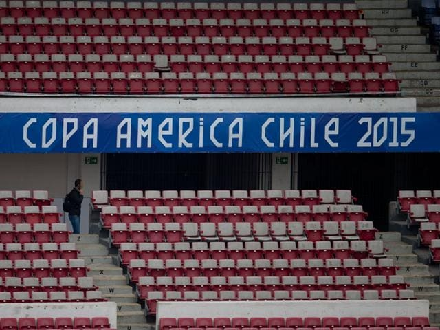 A-man-walks-on-the-stands-of-the-National-Stadium-in-Santiago-Chile-on-Tuesday-June-9-2015-The-opening-Copa-America-soccer-between-Chile-and-Ecuador-will-take-place-at-the-stadium-on-Thursday-AP-Photo