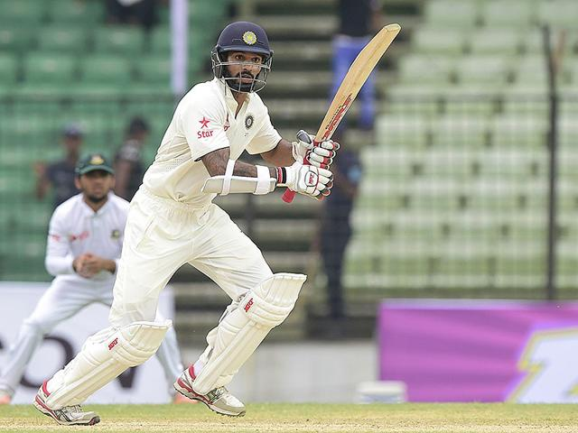 Shikhar-Dhawan-plays-a-shot-during-the-first-day-of-the-Test-match-between-Bangladesh-and-India-at-Fatullah-Bangladesh-on-June-10-2015-AFP-Photo