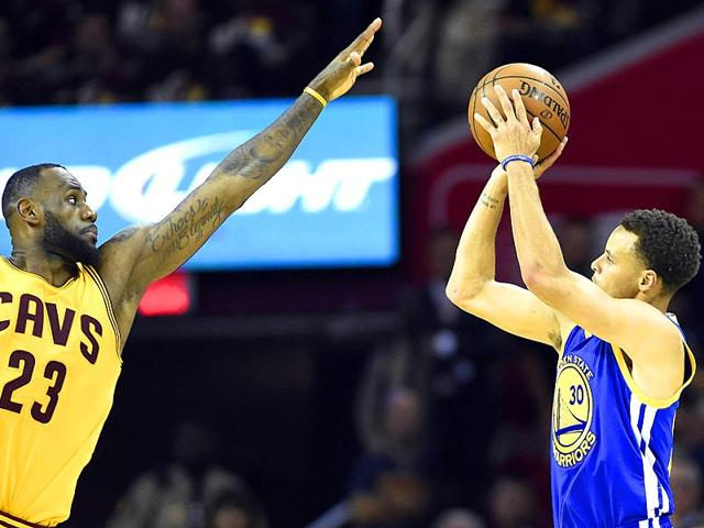 Golden-State-Warriors-guard-Stephen-Curry-30-shoots-the-ball-over-Cleveland-Cavaliers-forward-LeBron-James-23-during-the-fourth-quarter-in-game-three-of-the-NBA-Finals-at-Quicken-Loans-Arena-Bob-Donnan-USA-TODAY-Sports