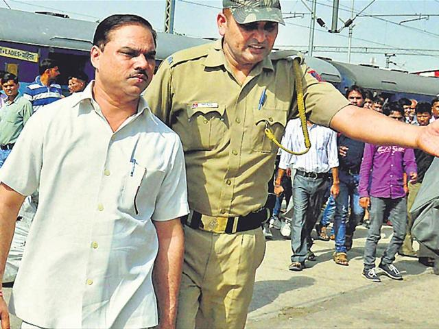 Jitender-Tomar-who-quit-as-Delhi-law-minister-after-his-arrest-on-charges-of-faking-his-college-degrees-at-Charbargh-railway-station-in-Lucknow-on-his-way-to-Faizabad-on-Wednesday-PTI-Photo