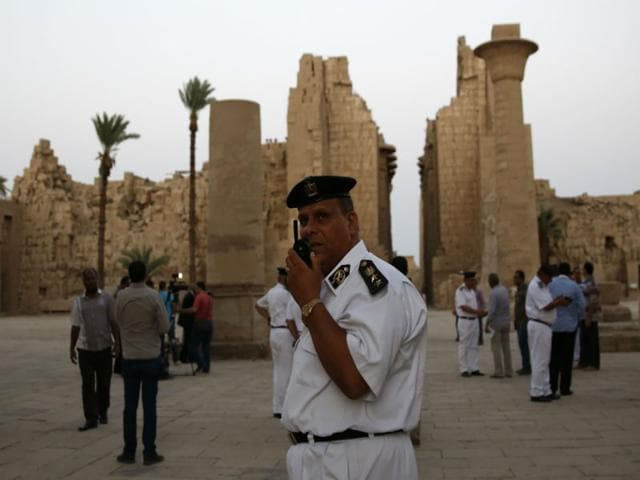Egyptian-security-officials-stand-guard-as-tourists-visit-the-ruins-of-the-Karnak-Temple-in-Luxor-after-a-suicide-bomber-blew-himself-up-on-Wednesday-just-steps-away-from-the-ancient-temple-AP-Photo