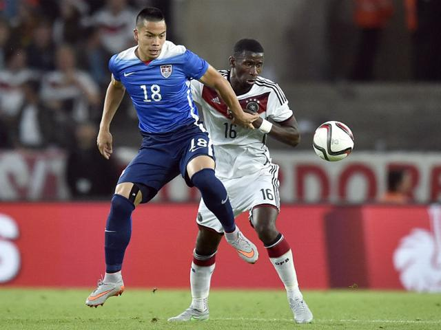 Germany-s-Antonio-Ruediger-right-and-United-States-Bobby-Wood-left-challenge-for-the-ball-during-the-soccer-friendly-match-between-Germany-and-the-United-States-in-Cologne-Germany-on-Wednesday-June-10-2015-USA-defeated-Germany-2-1-AP-Photo