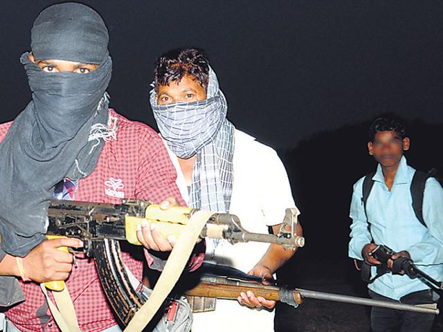 A-PLFI-platoon-with-a-minor-member-extreme-right-flaunting-automatic-weapons-they-acquired-recently-HT-File-Photo