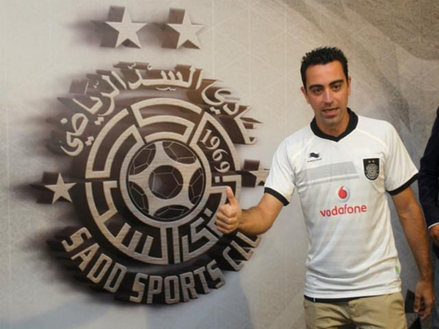 Barcelona-legend-Xavi-Hernandez-poses-for-a-photo-in-his-new-Al-Sadd-club-shirt-after-signing-a-two-year-contract-with-the-Qatari-team-in-Doha-on-June-11-2015-AFP-Photo