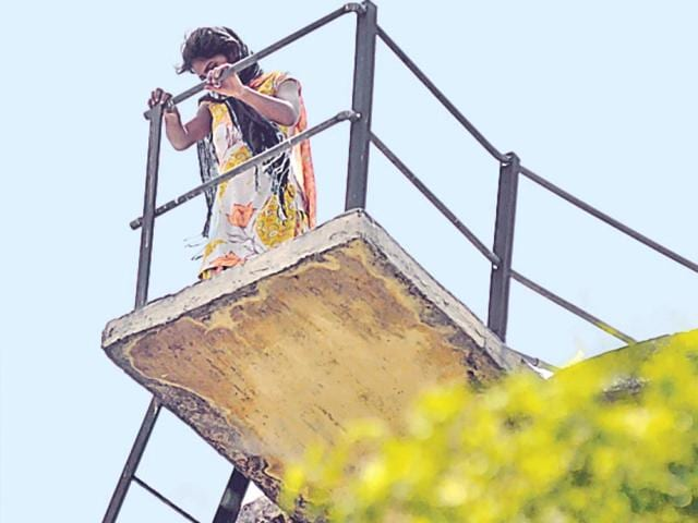 The-gangrape-victim-climbed-atop-an-overhead-tank-in-Shyama-Prasad-Mukherjee-Hospital-Lucknow-on-Thursday-and-threatened-to-end-her-life-if-she-was-not-assured-justice-Finally-she-was-persuaded-to-come-down-Deepak-Gupta-HT-Photo