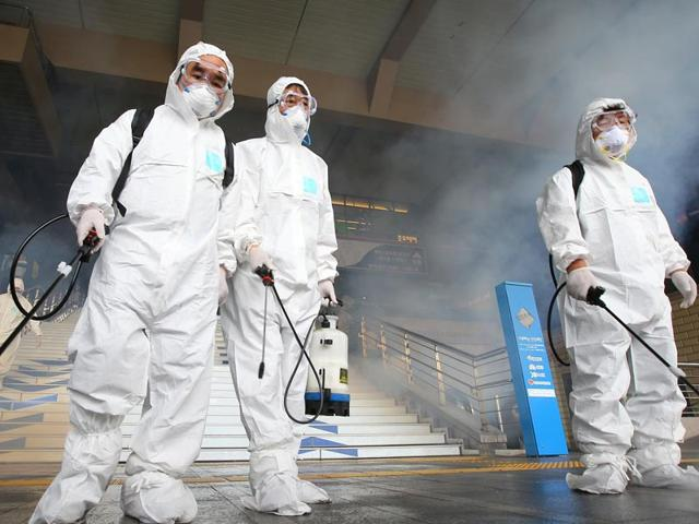 Employees-from-Seoul-Metropolitan-Rapid-Transit-Corp-disinfect-the-interior-of-its-train-in-Seoul-on-Thursday-Reuters-photo