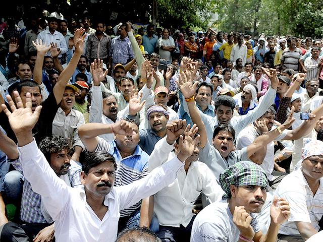 Sanitation-workers-stage-protest-against-the-non-payment-of-salaries-at-the-MCD-office-in-Patparganj-New-Delhi-Sonu-Mehta-HT-Photo