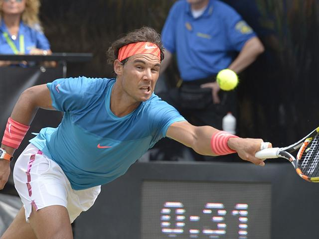 Rafael-Nadal-returns-the-ball-to-Australia-s-Bernard-Tomic-during-their-quarterfinal-match-at-the-ATP-Mercedes-Cup-tennis-tournament-in-Stuttgart-southern-Germany-on-June-12-2015-AFP-Photo