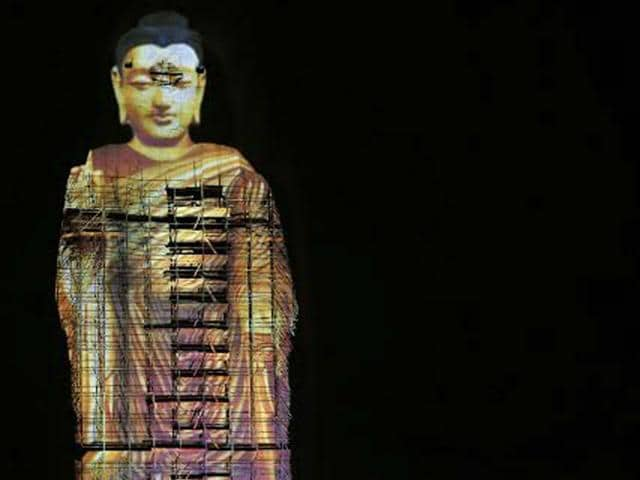 The-projected-image-of-a-Buddha-statue-in-Bamiyan-that-had-been-destroyed-by-the-Taliban-in-2001-AFP-Photo