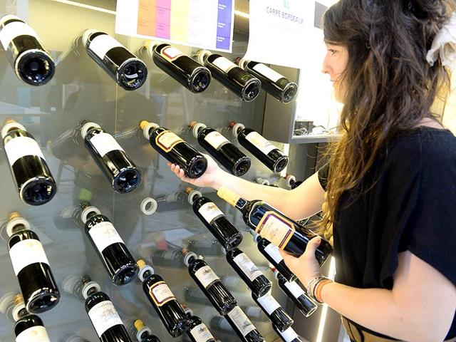 An-employee-prepares-bottles-of-wine-two-days-ahead-of-the-International-Wine-and-Spirits-fair-Vinexpo-in-Bordeaux-western-France-AFP-Photo