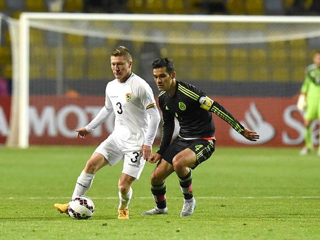 Bolivia-midfielder-Alejandro-Chumacero-L-vies-for-the-ball-with-Mexico-defender-Rafael-Marquez-during-their-2015-Copa-America-match-in-Vina-del-Mar-Chile-on-June-12-2015-AFP-Photo