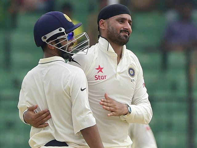 Harbhajan-Singh-celebrates-with-teammate-Ajinkya-Rahane-after-dismissing-a-Bangladesh-batsman-during-the-one-off-Test-match-between-Bangladesh-and-India-at-Fatullah-on-June-13-2015-AFP-Photo