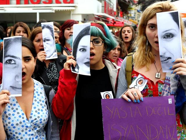 Turkish-women-display-photographs-of-slain-student-zgecan-Aslan-who-was-killed-while-resiting-an-attempted-rape-and-other-victims-of-violence-against-women-during-a-demonstration-in-Ankara-on-June-12-2015-AFP-photo