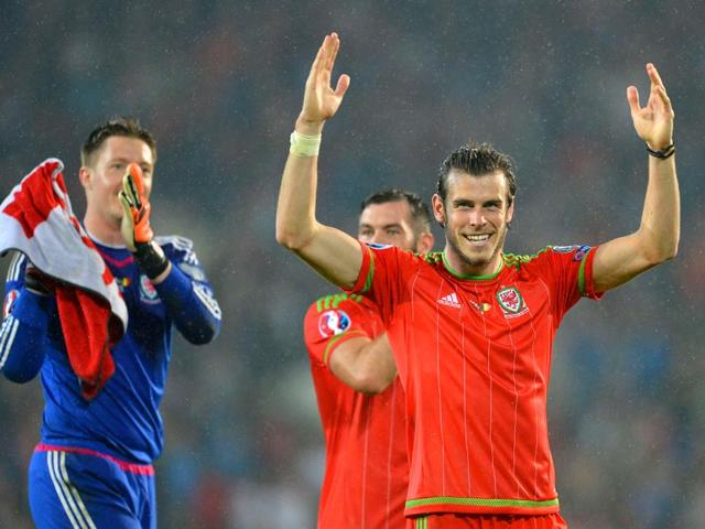Gareth-Bale-R-gestures-to-the-crowd-after-the-final-whistle-of-the-Euro-2016-qualifying-group-B-football-match-between-Wales-and-Belgium-at-Cardiff-City-Stadium-in-Cardiff-south-Wales-on-June-12-2015-AFP-Photo