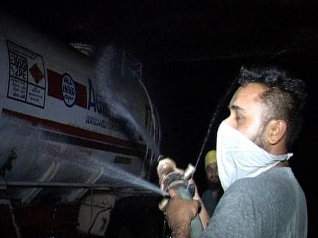 A-man-pouring-water-on-the-tanker-to-reduce-the-impact-of-the-ammonia-gas-in-Ludhiana-on-Saturday-JS-Grewal-HT