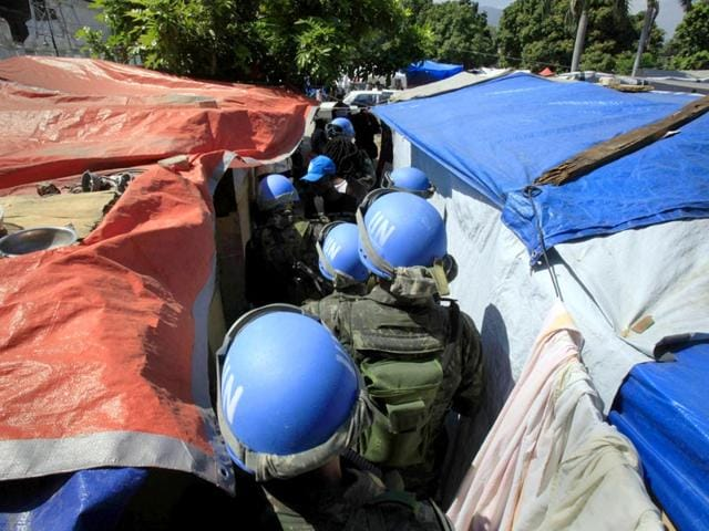 In-recent-years-global-peacekeeping-forces-have-faced-mounting-accusations-of-sexual-harassment-and-abuse-of-authority-especially-in-impoverished-areas-AP-Photo-Jorge-Saenz