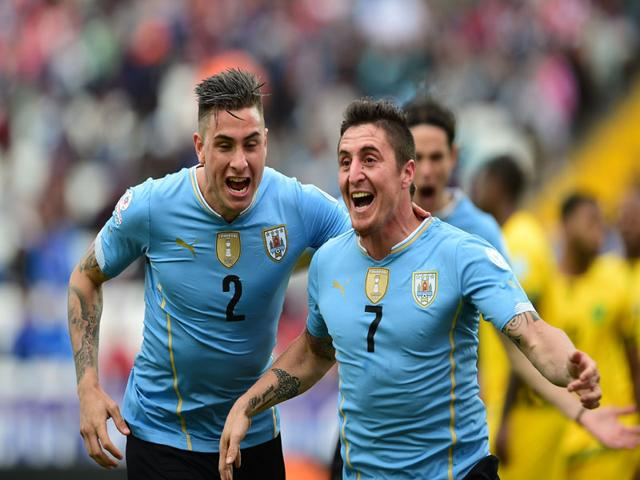 Uruguay-s-midfielder-Cristian-Rodriguez-R-celebrates-after-scoring-against-Jamaica-during-their-2015-Copa-America-football-championship-match-in-Antofagasta-northern-Chile-on-June-13-2015-Uruguay-won-1-0-AFP-Photo