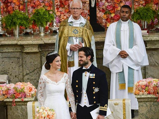 Swedish-Prince-Carl-Philip-and-Sofia-Hellqvist-with-Reverend-Lars-Goran-Lonnermark-and-Reverend-Michael-Bjerkehagen-during-their-wedding-in-the-Royal-Chapel-Reuters-Photo