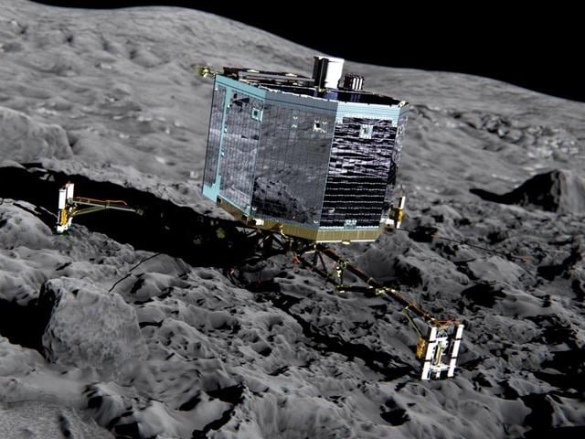 French-President-Francois-Hollande-center-with-French-astrophysicist-Francis-Rocard-look-at-a-model-of-Rosetta-lander-Philae-AP-Photo