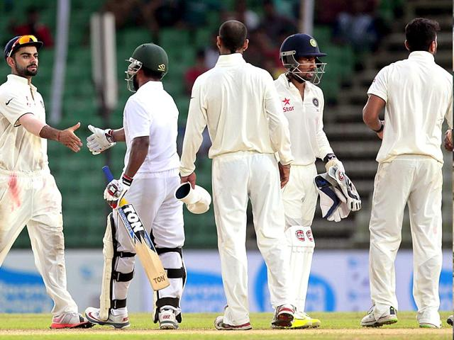 India-s-captain-Virat-Kohli-L-shakes-hand-with-Bangladesh-s-Imrul-Kayes-2nd-L-after-the-Test-match-between-the-two-sides-ended-in-a-draw-at-Fatullah-on-June-14-2015-AP-Photo