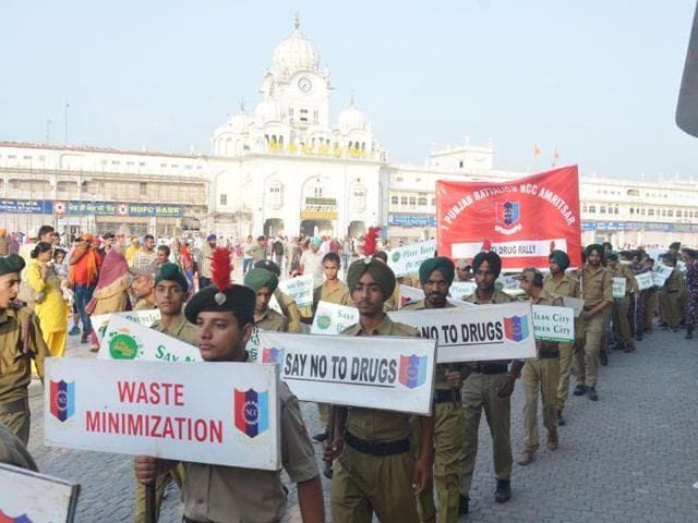 Students-and-NCC-cadets-holding-placards-as-they-participate-in-an-awareness-march-to-mark-the-438th-Amritsar-foundation-Day-in-Amritsar-Sameer-Sehgal-HT