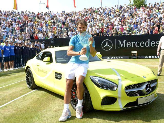 Spain-s-Rafael-Nadal-poses-on-the-winner-s-car-a-Mercedes-AMG-GTS-with-the-trophy-after-defeating-Serbia-s-Viktor-Troicki-in-the-final-of-the-Mercedes-Cup-in-Stuttgart-Germany-on-June-14-2015-AFP-Photo
